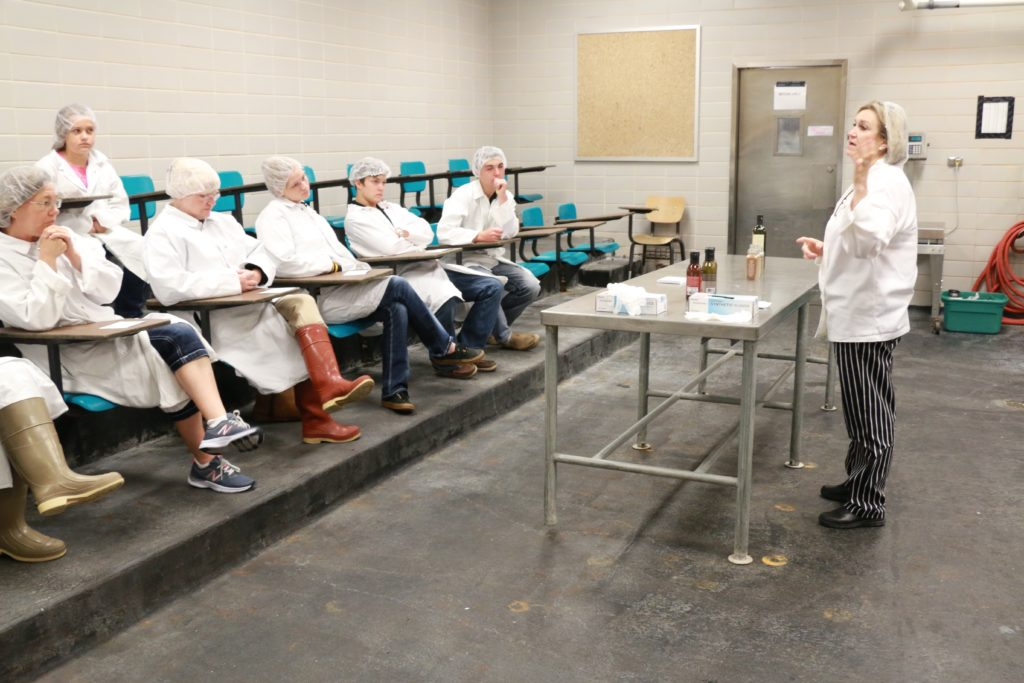 Lisa Fritz, H-E-B, discussing different seasonings